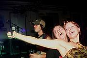 Girls enjoying themselves, Skindred gig, Porth, Wales 2006