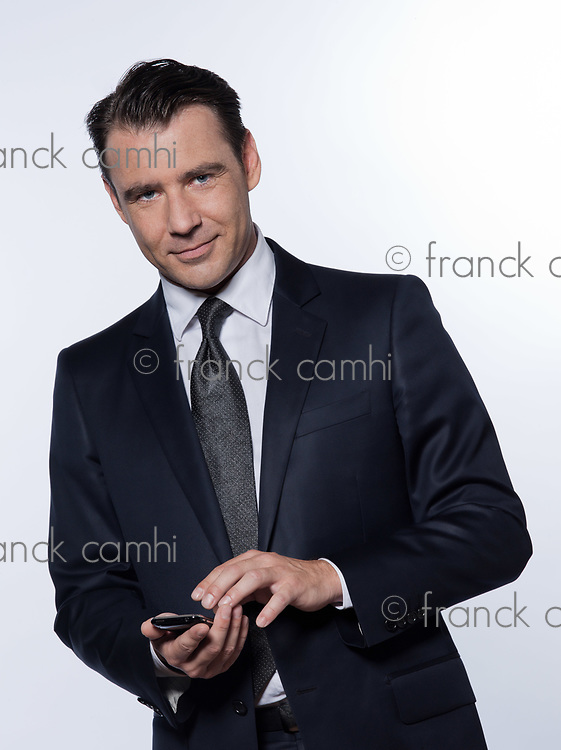 handsome caucasian man phoning portrait isolated studio on white background wearing suit