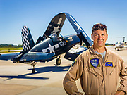 Commemorative Air Force pilot Alan Armstrong, photographed with a WWII Corsair at Atlanta's Dekalb Peachtree Airport.<br /> <br /> Created by aviation photographer John Slemp of Aerographs Aviation Photography. Clients include Goodyear Aviation Tires, Phillips 66 Aviation Fuels, Smithsonian Air & Space magazine, and The Lindbergh Foundation.  Specialising in high end commercial aviation photography and the supply of aviation stock photography for advertising, corporate, and editorial use.