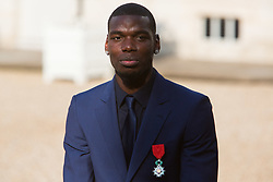 France's national Paul Pogba leaves after receiving the Legion of Honour during a ceremony to award French 2018 football World Cup winners, on June 4, 2019, at the Elysee Palace in Paris. Photo by Raphael Lafargue/ABACAPRESS.COM
