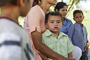 A boy sits on his mother's lap during a vaccination session at the primary school in the town of Coyolito, Honduras on Wednesday April 24, 2013.
