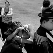"Isidro ""Kiki"" Vargas is consoled by his sister, Yolanda, while others pay respects at the gravesite during Andrew's funeral."