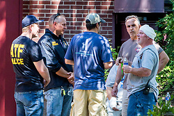 August 2, 2017 - Minneapolis, Minnesota, U.S. - ATF officers speak to people outside of Minnehaha Academy following an explosion and partial building collapse. One person was killed and one is unaccounted for in an explosion at the Minnehaha Academy upper school, officials said. Nine were injured, and three of them are in critical condition. (Credit Image: © Courtney Pedroza/TNS via ZUMA Wire)