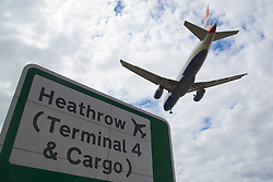 © Licensed to London News Pictures. 29/07/2015. Heathrow, UK. An aircraft coming in to land  at Heathrow airport. There has been a long running dispute over the expansion and extension of a third runway at the UK's largest airport. A recent report by the Airports Commission recommended that a third runway be built at Heathrow ahead of plans to build a new airport or expand Gatwick. Photo credit : Ian Wylie/LNP