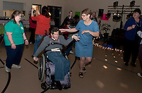 Laura Michaelis, Sean Murphy and Susan Gunther Director of the Family Support Council enjoy moving and grooving on the dance floor Friday evening at the GIlford Youth Center.  (Karen Bobotas/for the Laconia Daily Sun)