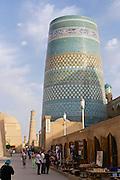 Uzbekistan, Khiva, Ichon-Qala.<br /> Kalta Minor Minaret, souvenir shops.