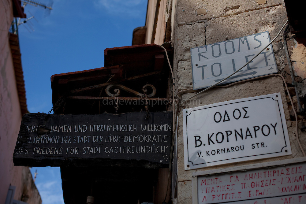 "Abandoned Herbalist Shop, Rethymno, Crete owned, apparently, by Panajiotis and or Dimitrios Kontogianis. The sign reads ""Ladies and Gentlemen welcome to Rethymno, city of love,  democratic peaceful and hospitable city"""