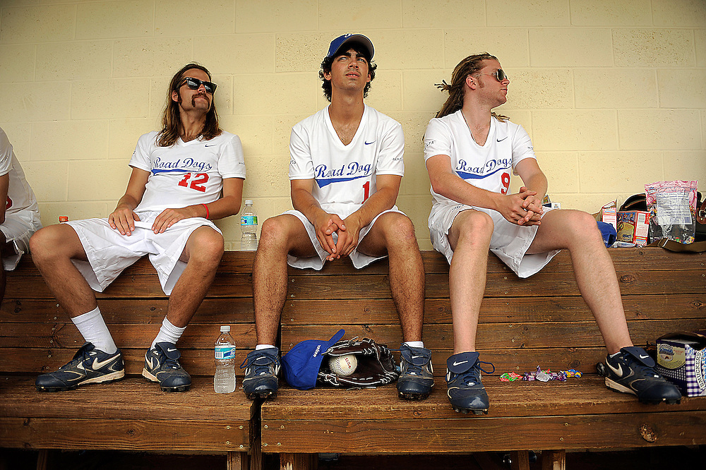 "AUGUST 19, 2009 BOCA RATON FLORIDA- Joe Jonas, of the Jonas Brothers, sits in the dugout with two of his teammates during their softball game against the Marquis Flyers. The Jonas Brothers and their team, the ""Road Dogs"" took part in the softball game which was being held by Marquis Jet at the Saint Andrews School in Boca Raton, Fla. Marquis Jet has held 9 other softball games around the country as their company team the ""Marquis Flyers"" competes in for fun games against various teams. PHOTO BY JOSH RITCHIE"
