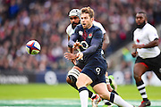 England fly half George Ford off loads the ball during the Autumn International Series match between England and Fiji at Twickenham, Richmond, United Kingdom on 19 November 2016. Photo by Ian  Muir.