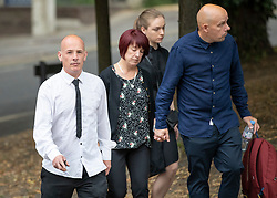 © Licensed to London News Pictures. 18/07/2018. Woking, UK.  The family of Private (Pte) Sean Benton arrive at Woking Coroner's Court.  Pte Benton's sister Tracy Lewis (2L) and twin brother Tony Benton (L) will hear the coroner read out his full ruling today. Pte Sean Benton was found with five gunshot wounds to his chest at Deepcut army base in 1995. Photo credit: Peter Macdiarmid/LNP