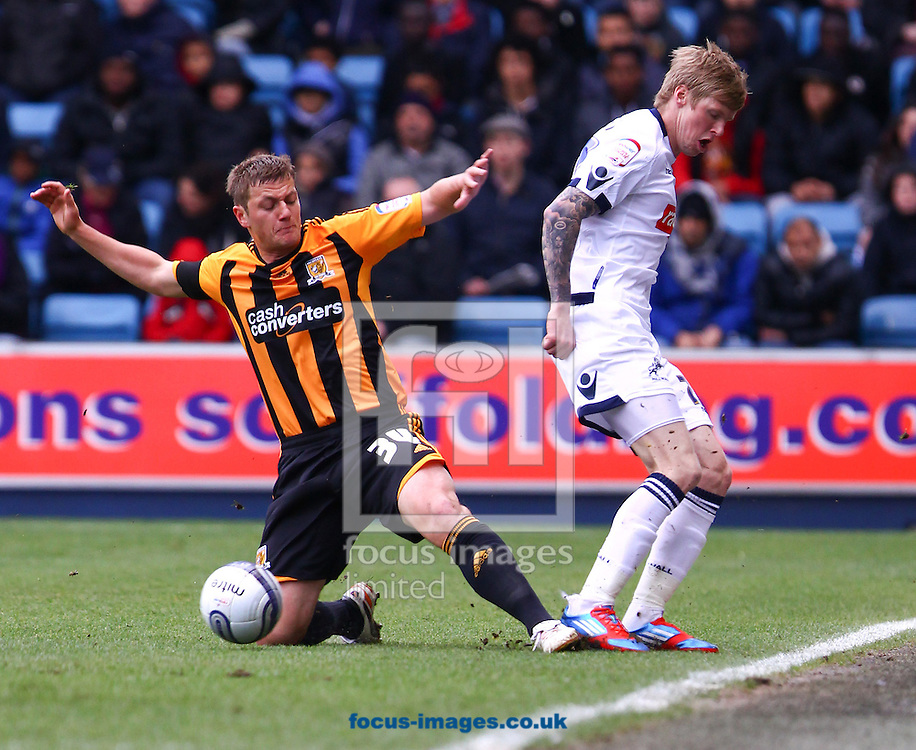 Picture by John Rainford/Focus Images Ltd. 07506 538356.07/04/12.Andy Keogh of Millwall and Liam Cooper of Hull City during the Npower Championship match at The Den stadium, London.
