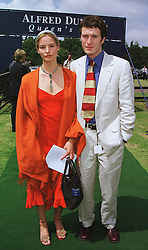 Actor NICK MORAN and MISS SIENNA GUILLORY at a polo match in Berkshire on 13th June 1999.MTD 56