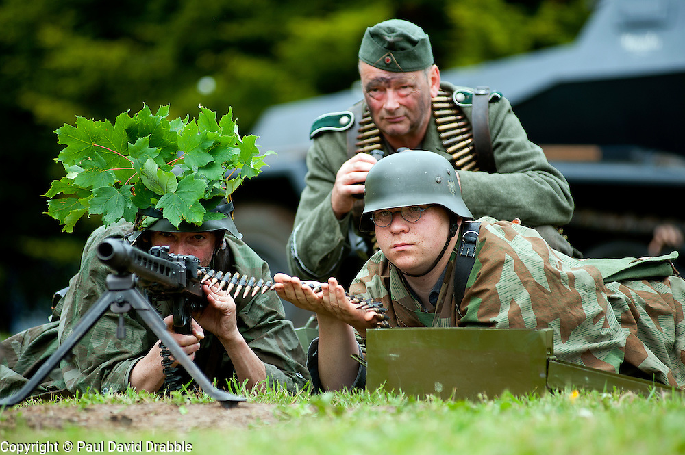 Reenactors portray a three man MG42 machine gun crew from the Panzer Grenadier Division GrossDeutschland at the Northallerton Wartime Weekend<br />