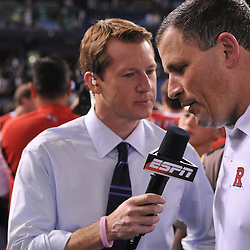 Dec 20, 2009; St. Petersburg, Fla., USA; Rutgers head coach Greg Schiano is interviewed on ESPN following Rutgers' 45-24 victory over Central Florida in the St. Petersburg Bowl at Tropicana Field.