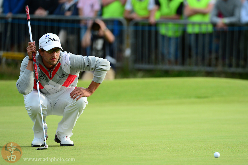 July 21, 2012; St. Annes, ENGLAND; Adam Scott lines up his putt on the 18th hole during the third round of the 2012 British Open Championship at Royal Lytham & St. Annes Golf Club.