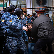 Members of Russia's OMON (Special Force) beat a Reuters photographer in Moscow. The photograhper, Thomas Peters from Germany, while photographing an anti-Kremlin march led by Garry Kasparov, the former world chess champion who now leads one of Russia's strongest opposition movements...The demonstration, one in a series of so-called Dissenters' Marches, increased tension between opposition supporters who complain the Kremlin is cracking down on political dissent and authorities who vow to block any unauthorized demonstrations.