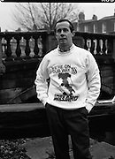 """Liam Brady Models World Cup Sweatshirt.  (T11)..1989..06.12.1989..12.06.1989..6th December 1989..To celebrate qualification for the World Cup at """"Italia 90"""" a range of clothing was produced for the many fans who would travel to Italy. Thousands of Irish fans are already making arrangements to follow the 'Boys In Green', on hopefully a journey to World Cup glory...Image shows Ireland midfielder, Liam Brady, modeling one of the shirts produced for fans supporting the Irish team in Italy. Liam Brady Modello per le felpe della coppa del mondo. Per celebrare la qualificazione ai mondiali di calcio, fu prodotta una linea di vestiti """"Italia 90"""" per molti fans."""
