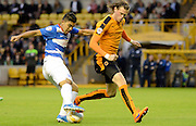 Richard Stearman attempts to tackle Massimo Luongo during the Sky Bet Championship match between Wolverhampton Wanderers and Queens Park Rangers at Molineux, Wolverhampton, England on 19 August 2015. Photo by Alan Franklin.