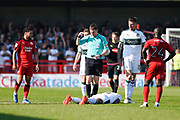 Referee Ben Toner surveys the injury to Plymouth Argyle defender Yann Songo'o (4), after Crawley Town forward James Collins (19) is sent off during the EFL Sky Bet League 2 match between Crawley Town and Plymouth Argyle at the Checkatrade.com Stadium, Crawley, England on 8 April 2017. Photo by David Charbit.