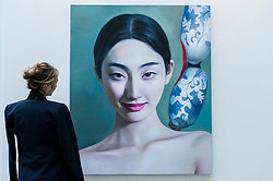 "© Licensed to London News Pictures. 19/05/2016. London, UK. A visitor looks at Ling Qian's ""Porcelain"".  Art16 opens at Olympia, in west London.  Now in its fourth edition, the fair brings together over 100 galleries from more than 30 countries showcasing a diverse cross-section of work by contemporary artists from around the world for buyers and art enthusiasts to visit. Photo credit : Stephen Chung/LNP"