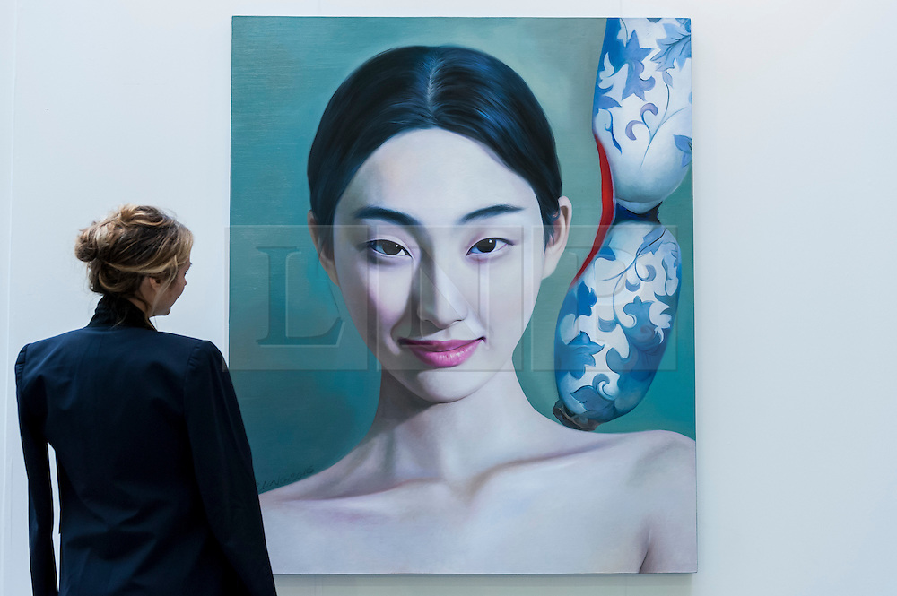 """© Licensed to London News Pictures. 19/05/2016. London, UK. A visitor looks at Ling Qian's """"Porcelain"""".  Art16 opens at Olympia, in west London.  Now in its fourth edition, the fair brings together over 100 galleries from more than 30 countries showcasing a diverse cross-section of work by contemporary artists from around the world for buyers and art enthusiasts to visit. Photo credit : Stephen Chung/LNP"""