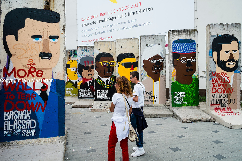sections of original Berlin Wall painted with world leaders at Checkpoint Charlie in Berlin Germany
