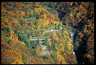 Waterfall & Iroha highway nestle in palette of autumn colors in Nikko mountains at Lake Chuzenji Japan