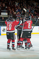 KELOWNA, CANADA - OCTOBER 11: Nick Merkley #10, Tyrell Goulbourne #12, Madison Bowey #4 and Colten Martin #8 of Kelowna Rockets celebrate a goal against the Lethbridge Hurricanes on October 11, 2014 at Prospera Place in Kelowna, British Columbia, Canada.   (Photo by Marissa Baecker/Shoot the Breeze)  *** Local Caption *** Tyrell Goulbourne; Nick Merkley; Madison Bowey; Colten Martin;