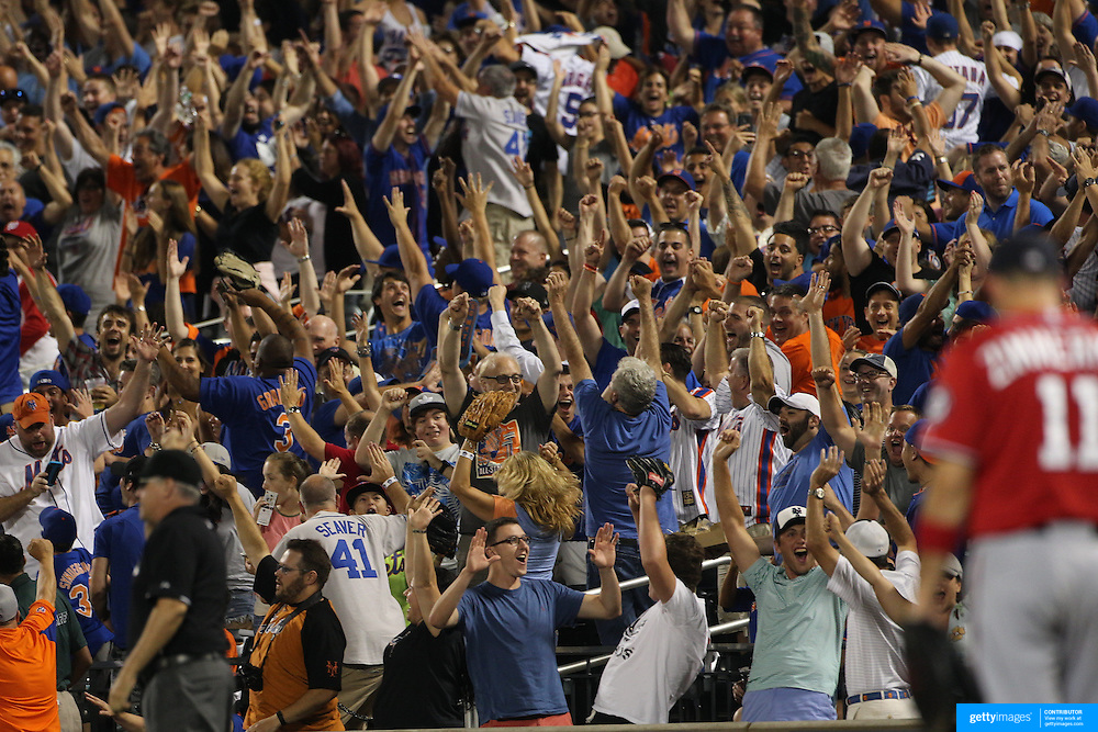 New York Mets fans go wild at a Lucas Duda, New York Mets, hits a two run home run off Jordan Zimmermann, (right), Washington Nationals, during the New York Mets Vs Washington Nationals MLB regular season baseball game at Citi Field, Queens, New York. USA. 2nd August 2015. Photo Tim Clayton