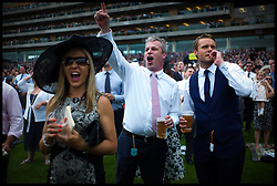 Racegoer's celebrate backing the winner in The Prince of Wale's Stakes on Day 2 of Royal Ascot, <br /> Ascot, United Kingdom<br /> Wednesday, 19th June 2013<br /> Picture by Andrew Parsons / i-Images