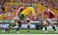 6 July 2013; James Horwill, Australia, is tackled by Alun Wyn Jones, left, and Dan Lydiate, British & Irish Lions. British & Irish Lions Tour 2013, 3rd Test, Australia v British & Irish Lions. ANZ Stadium, Sydney Olympic Park, Sydney, Australia. Picture credit: Stephen McCarthy / SPORTSFILE