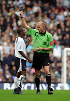Biting incident : Jermaine Defoe (Spurs) is booked by  Steve Bennett after biting  Javier Mascherano (West Ham) on his shoulder. BARCLAYS PREMIERSHIP. TOTTENHAM HOTSPUR v WEST HAM UNITED. 22/10/2006. CREDIT COLORSPORT / KIERAN GALVIN