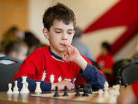 Finnian Mousseau from Pleasant Street School concentrates while awaiting his partners move during the  Laconia City Wide Chess Tournament at the Huot Center Saturday morning.  (Karen Bobotas/for the Laconia Daily Sun)