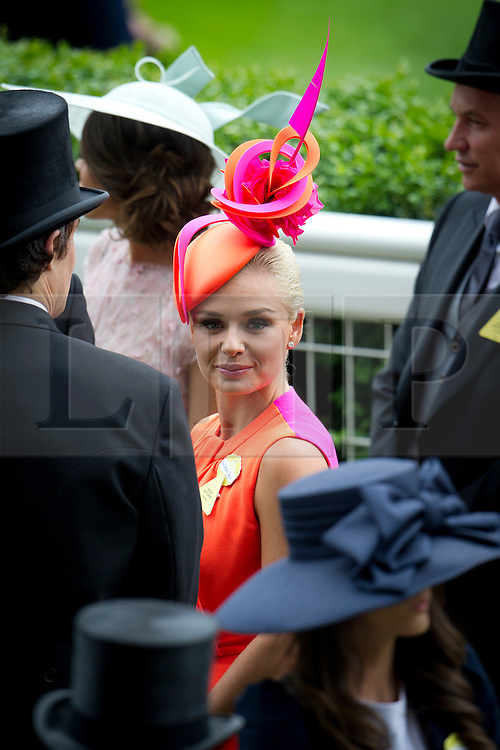 © London News Pictures. 18/06/2013. Ascot, UK.  Singer Katherine Jenkins (centre) attending day one of Royal Ascot at Ascot racecourse in Berkshire, on June 18, 2013.  The 5 day showcase event,  which is one of the highlights of the racing calendar, has been held at the famous Berkshire course since 1711 and tradition is a hallmark of the meeting. Top hats and tails remain compulsory in parts of the course. Photo credit should read: Ben Cawthra/LNP