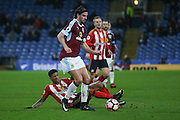 Sunderland defender Patrick van Aanholt (3)  can't get too Burnley midfielder George Boyd (21)  during the The FA Cup third round replay match between Burnley and Sunderland at Turf Moor, Burnley, England on 17 January 2017. Photo by Simon Davies.