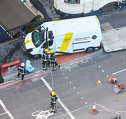 **PREVIOUSLY UNSEEN PICTURES** <br /> &copy; Licensed to London News Pictures. 04/06/2017. LONDON, UK.  Fighter fighters cut down a traffic light pole to allow the safe removal of the white van used by Khuram Butt, Rachid Redouane and Youssef Zaghba to murder at least eight people on London Bridge and in nearby Borough Market the day after the attack unfolded. Photo credit: Cliff Hide/LNP