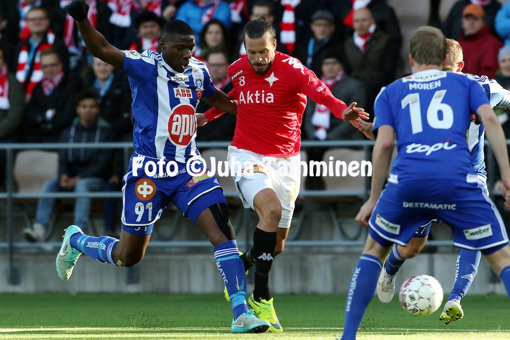 23.4.2015, Sonera Stadion, Helsinki.<br /> Veikkausliiga 2015.<br /> Helsingfors IFK - Helsingin Jalkapalloklubi.<br /> Jukka Halme (HIFK) v Guy Moussi (HJK).