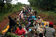 Internally displaced persons (IDPs) take a break on an armed AU peacekeeping convoy escorting about one thousand Muslims from the capital Bangui to the northern towns of Kabo and Sido, on the border with Chad.