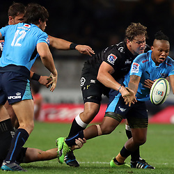 DURBAN, SOUTH AFRICA - JUNE 30: Etienne Oosthuizen of the Cell C Sharks tackling Tony Jantjies of the Vodacom Bulls during the Super Rugby match between Cell C Sharks and Vodacom Bulls at Growthpoint Kings Park on June 30, 2017 in Durban, South Africa. (Photo by Steve Haag/Gallo Images)