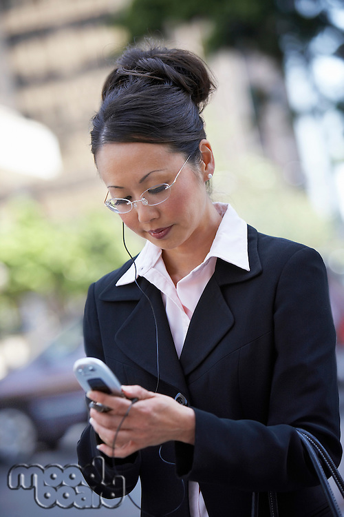 Businesswoman Dialing Cell Phone