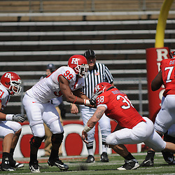 Apr 18, 2009; Piscataway, NJ, USA; Rutgers RB Joe Martinek (38) blocks DE Jonathan Freeny (99) during the first half of Rutgers' Scarlet and White spring football scrimmage.