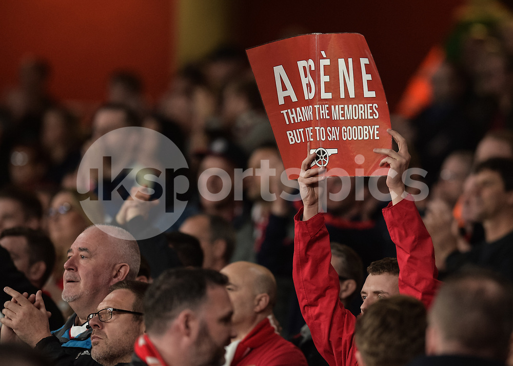Arsenal fans hold up banners against Arsène Wenger manager of Arsenal during the The FA Cup sixth round match between Arsenal and Lincoln City at the Emirates Stadium, London, England on 11 March 2017. Photo by Vince Mignott.