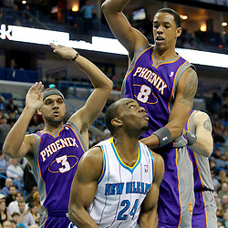 December 30, 2011; New Orleans, LA, USA; New Orleans Hornets power forward Carl Landry (24) is defended by Phoenix Suns small forward Jared Dudley (3) and center Channing Frye (8) during the first quarter of a game at the New Orleans Arena.   Mandatory Credit: Derick E. Hingle-US PRESSWIRE