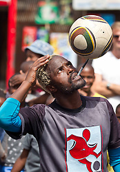 A football player shows off his trick skills on King Langalibalele Street during the Open Streets Langa event on 30 October 2016, when the street was closed to motorised vehicles and opened to people. Hosted by Open Streets Cape Town and supported by the City of Cape town and WWF. photo by John Tee/RealTime Images.