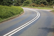 Sharp bend in road with double white lines