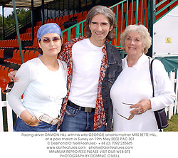 Racing driver DAMON HILL with his wife GEORGIE and his mother MRS BETTE HILL, at a polo match in Surrey on 19th May 2002.PAC 301