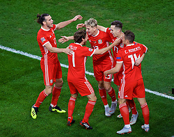CARDIFF, WALES - Thursday, September 6, 2018: Wales' Tom Lawrence celebrates scoring the first goal with team-mates during the UEFA Nations League Group Stage League B Group 4 match between Wales and Republic of Ireland at the Cardiff City Stadium. (Pic by Laura Malkin/Propaganda)
