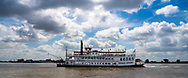 New Orleans, Louisiana, USA -- May 27, 2019.  Wide angle shot of the paddle wheel tourist boat Creole Queen on the Mississippi River.