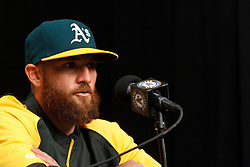 OAKLAND, CA - AUGUST 01:  Jonny Gomes #15 of the Oakland Athletics speaks during a press conference before the game against the Kansas City Royals at O.co Coliseum on August 1, 2014 in Oakland, California. (Photo by Jason O. Watson/Getty Images) *** Local Caption *** Jonny Gomes