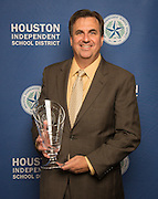 Houston Food Bank President & CEO Brian Greene poses with a Hall of Fame trophy following the Houston ISD Partnership Appreciation breakfast at Kingdom Builders, October 25, 2013.